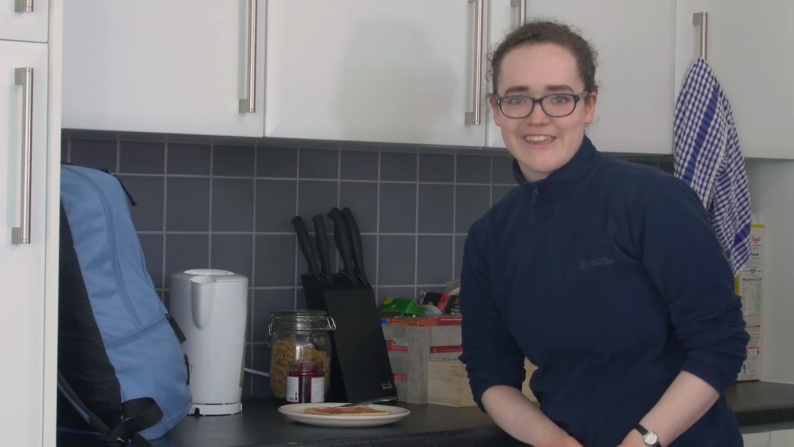 Still from LUFP narrative commercial Campus Community of actor Flora Barber in Lancaster University Halls kitchen