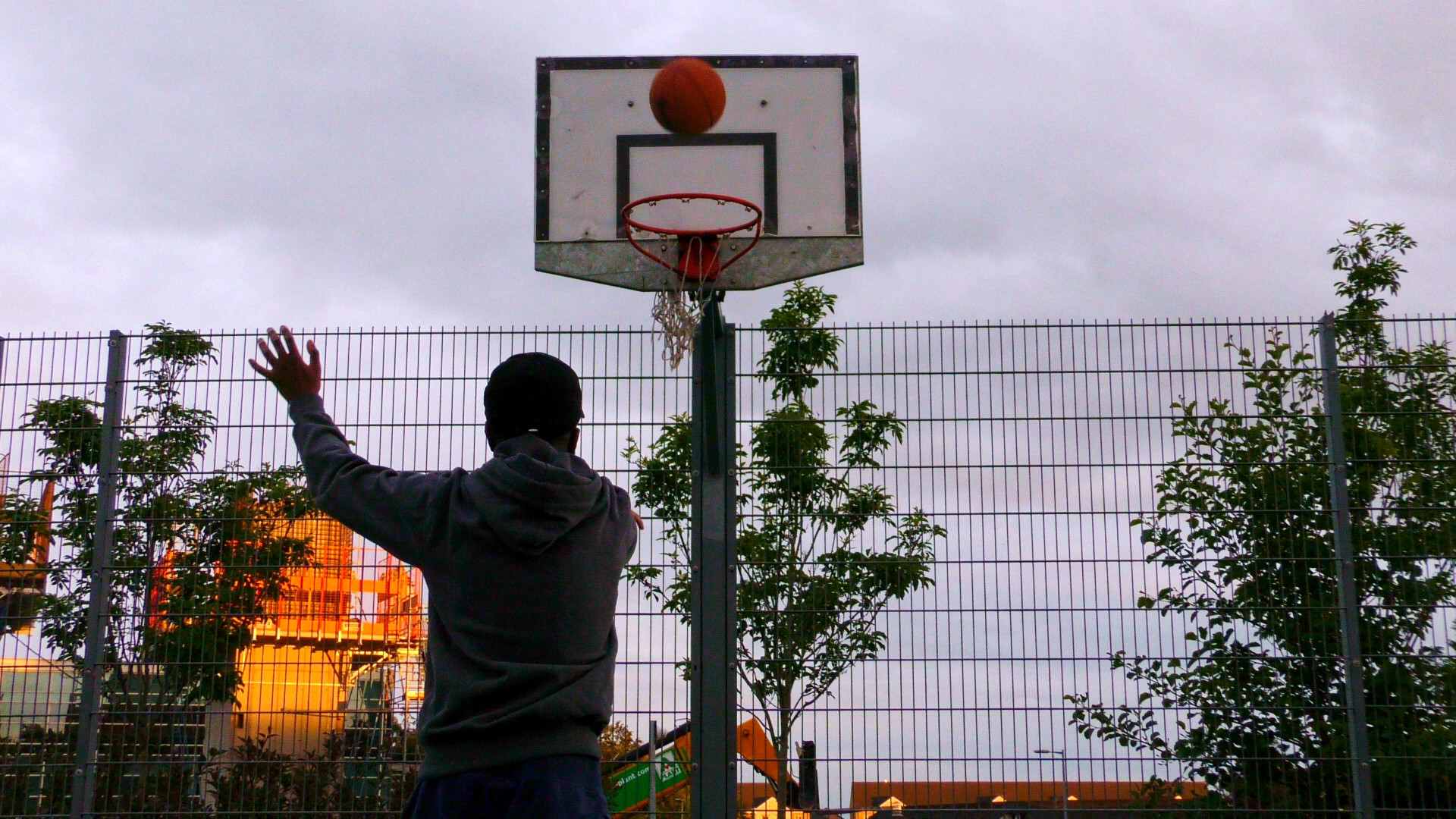 Still from Life Now Music Video of Jepeto Knockz shooting a basketball shot during golden hour, a Movement Films Production