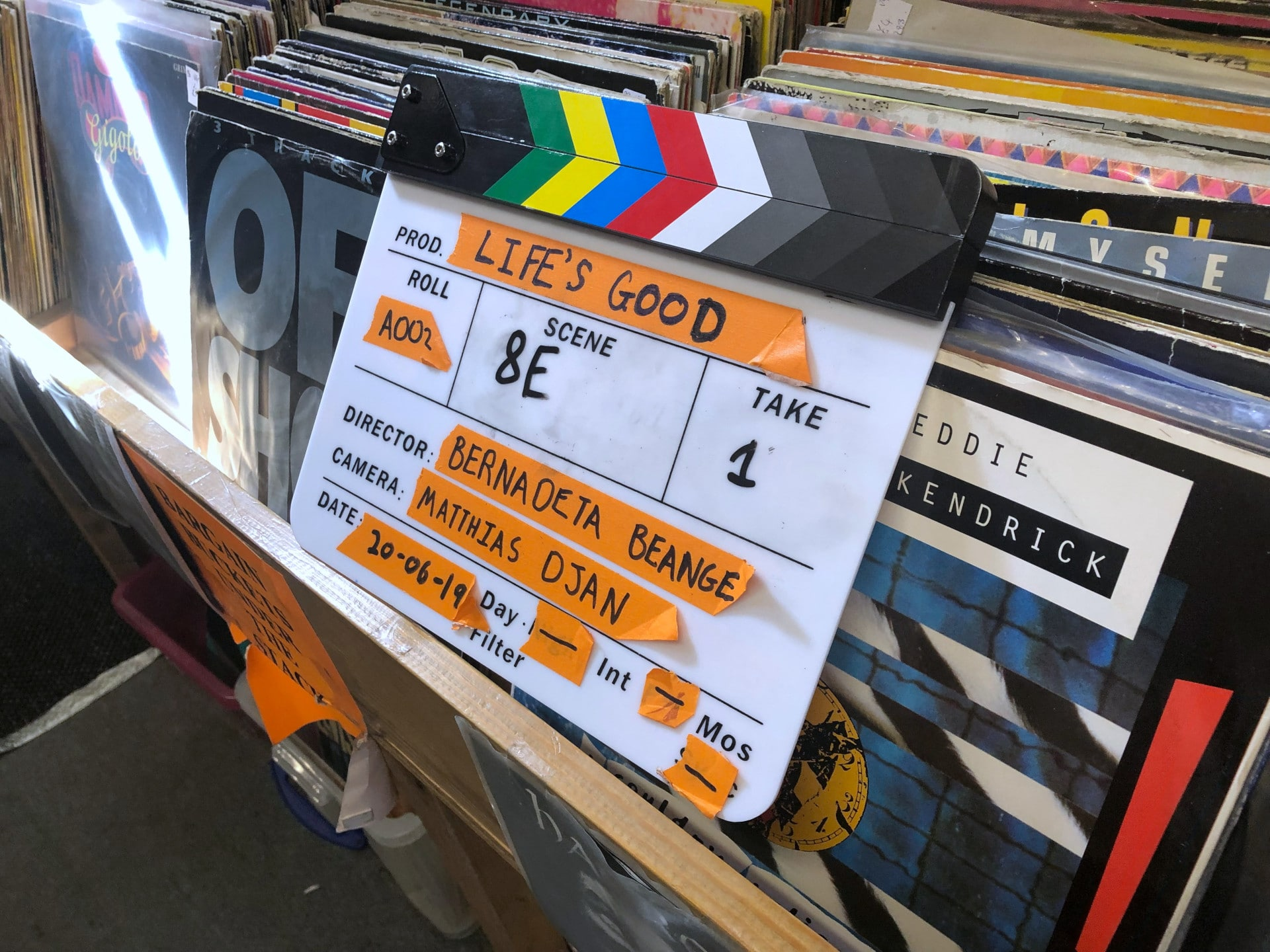 Behind the scenes photo of Movement Films narrative music video Jepeto Knockz: Life Now of clapperboard