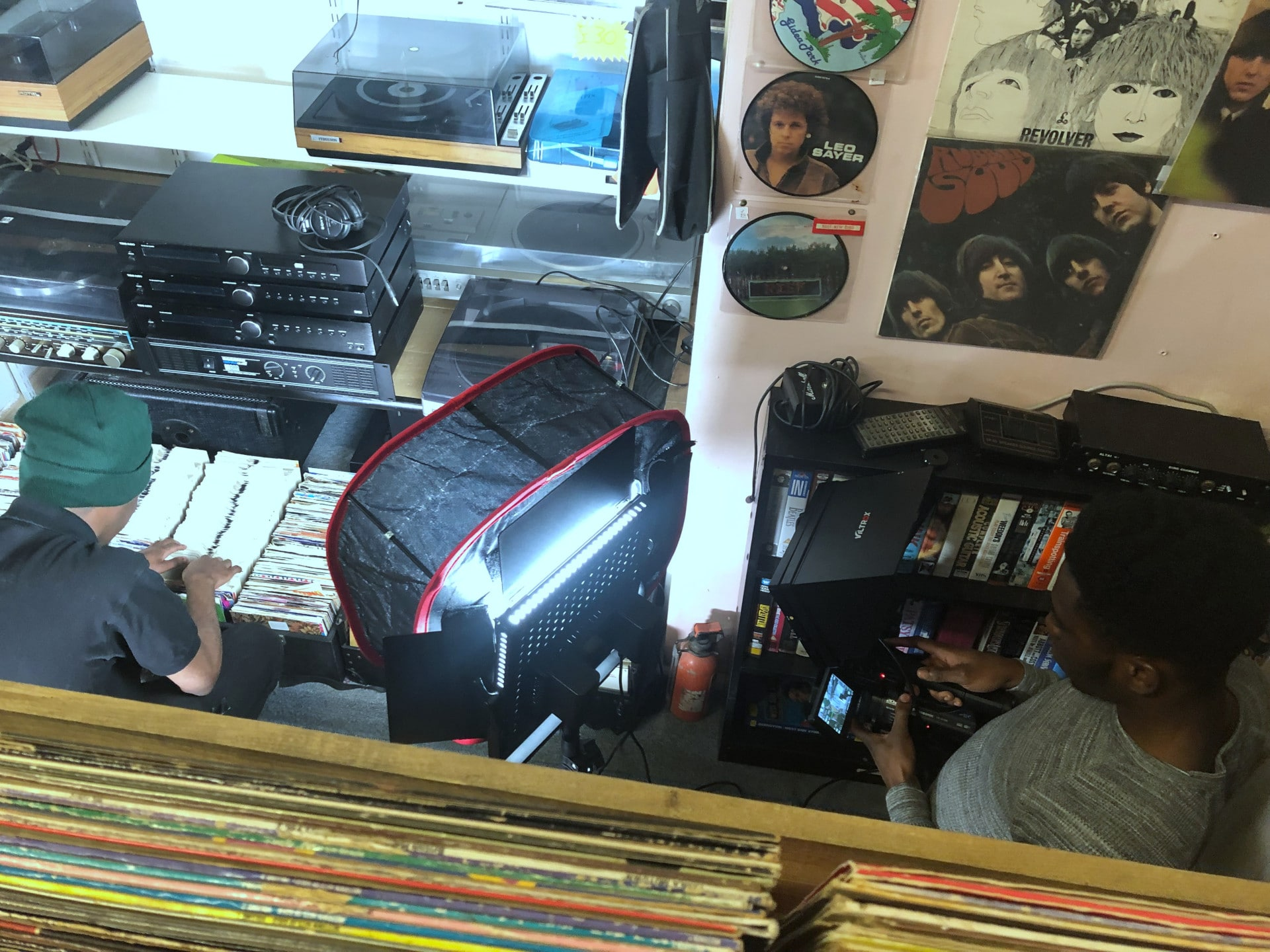 Behind the scenes photo of Movement Films narrative music video Life Now in Vintage Vinyls store