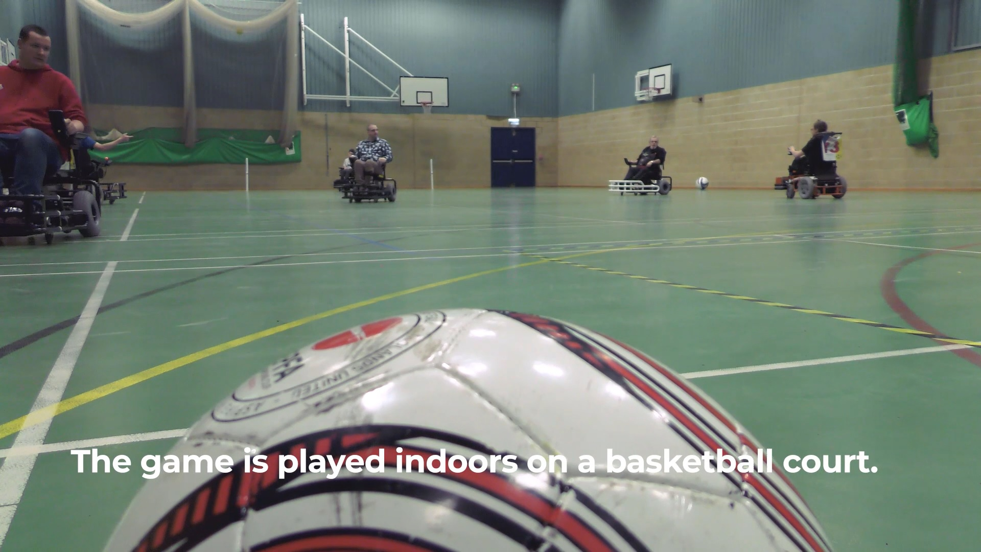 Still from Movement Films promotional video for Goals Beyond Grass Power Chair Football