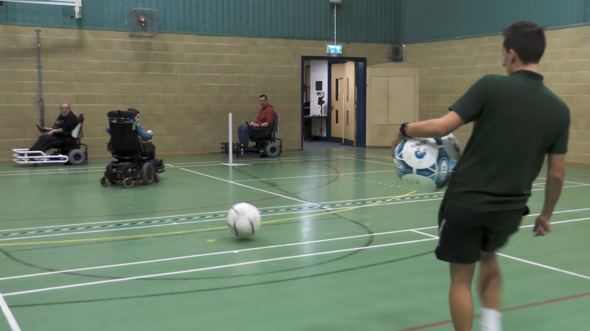 Still from Movement Films promotional video for Powerchair Football