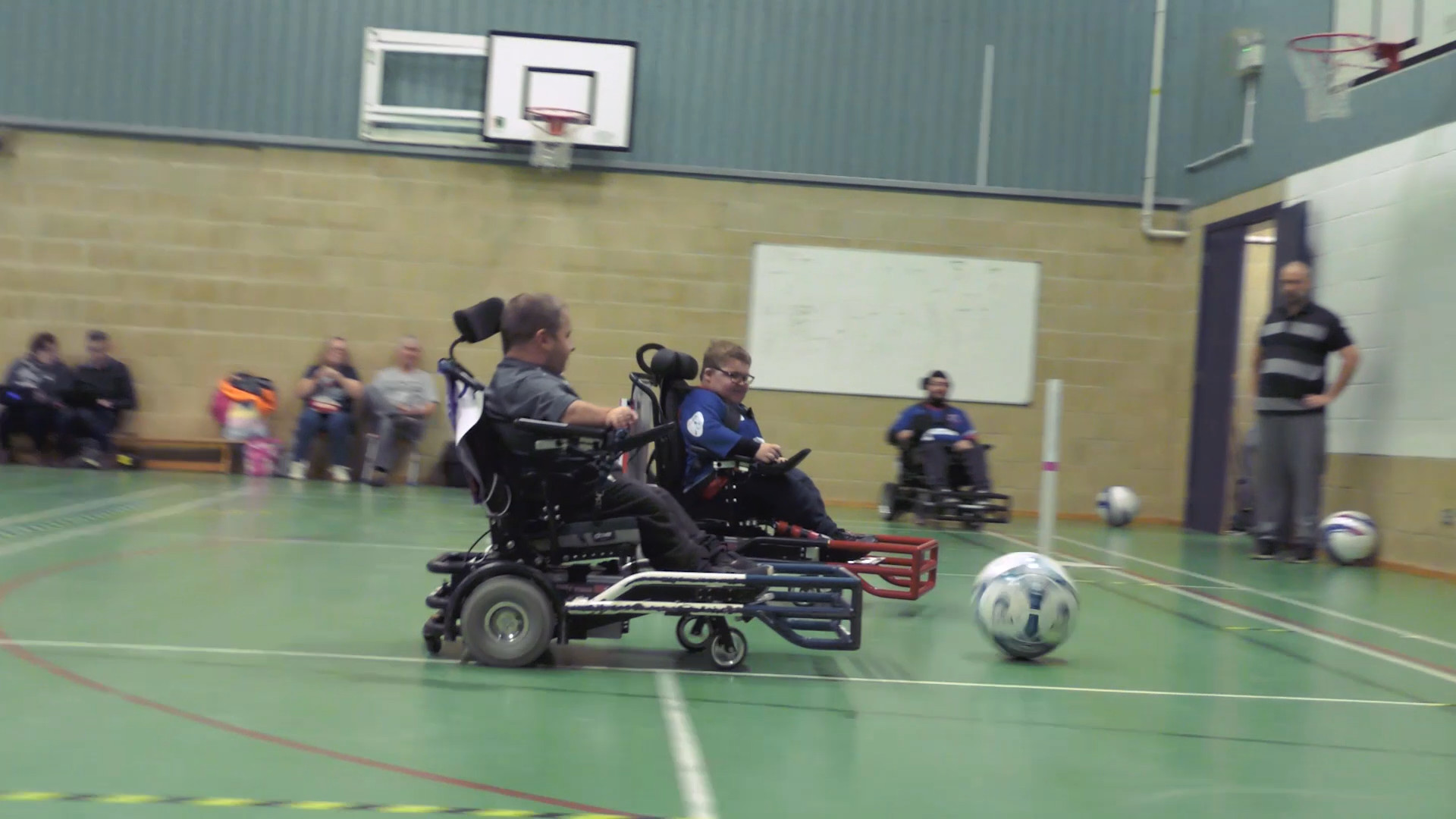 Still from Movement Films promotional video for Goals Beyond Grass Powerchair Football