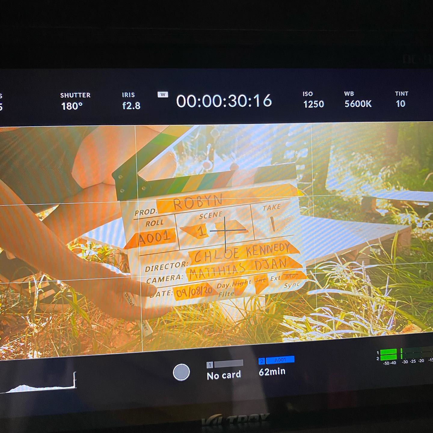 Behind the scenes image from short film Robyn showing a director's monitor displaying a clapperboard/slate