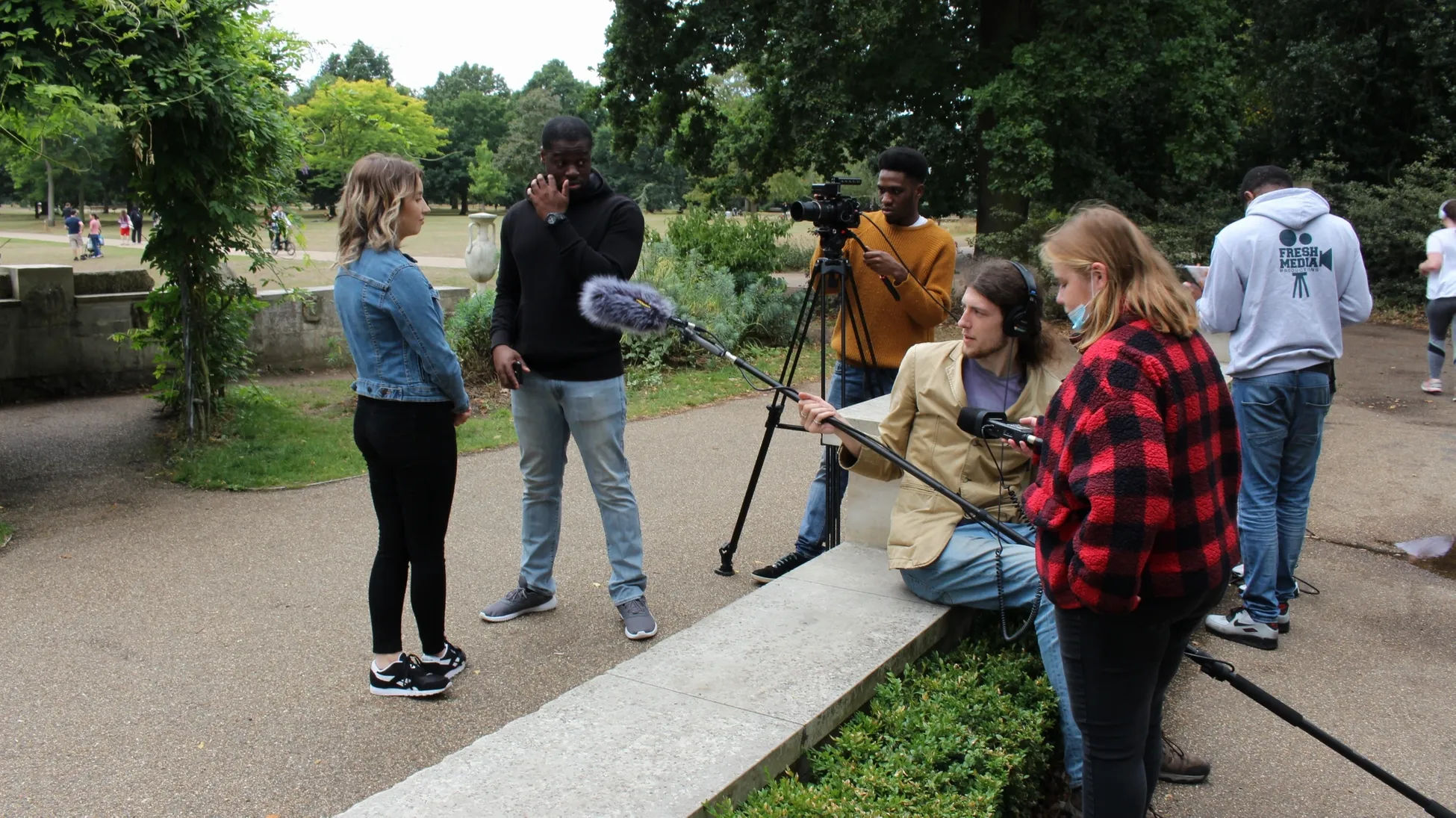 Behind the scenes from short film Fraudsters showing the crew for Fresh Media Productions project, shooting on location