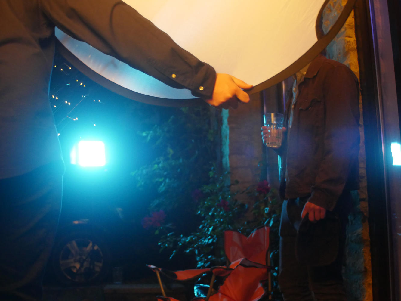 Behind the scenes image from short film Robyn showing a 5-in-1 reflector diffusing a light