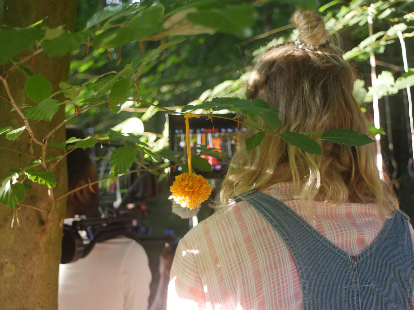 Behind the scenes image from short film Robyn of director Chloe Kennedy looking at her monitor