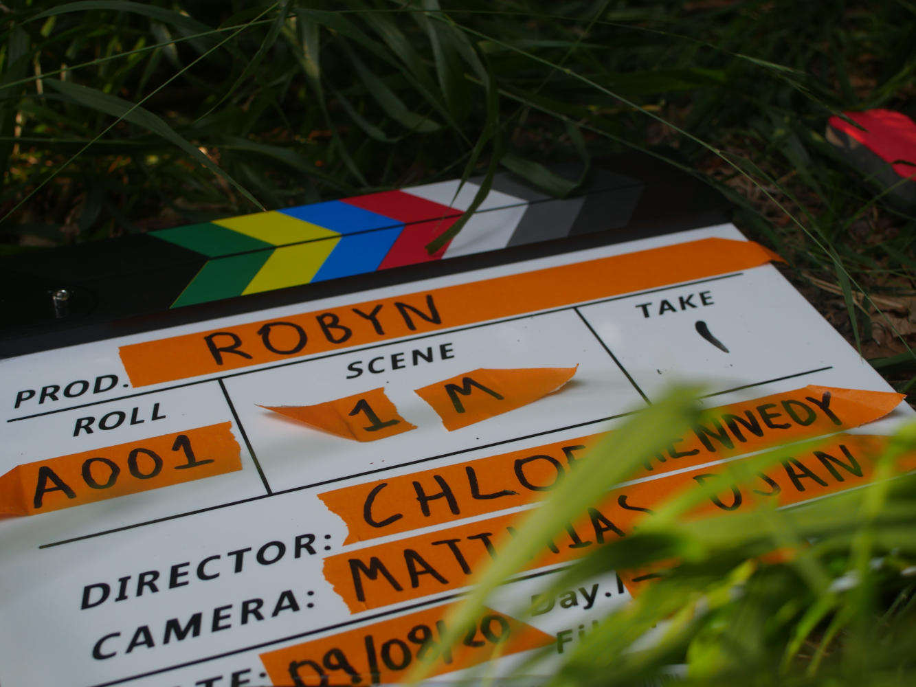 Behind the scenes image from short film Robyn of clapperboard/ slate