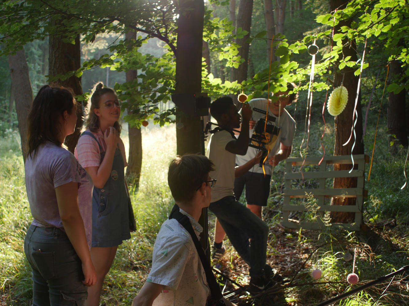 Behind the scenes image from short film Robyn of film crew in forest