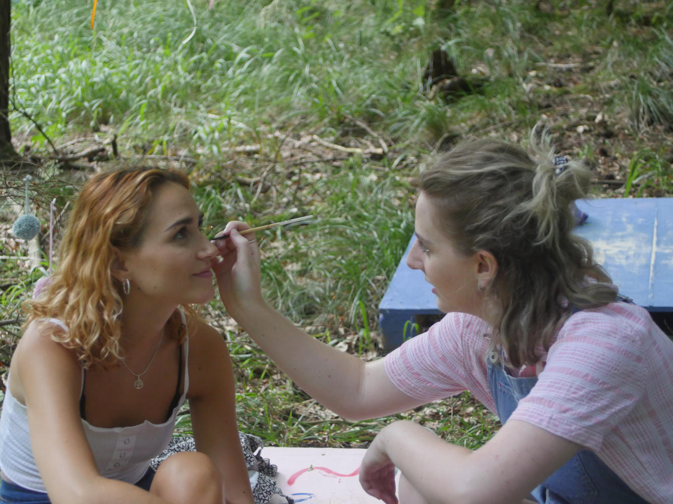 Behind the scenes image from short film Robyn of make up being applied on a film set