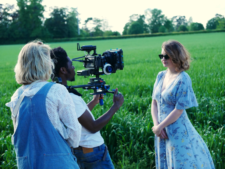 Behind the scenes photo of Cinematographer Matthias Djan camera operating