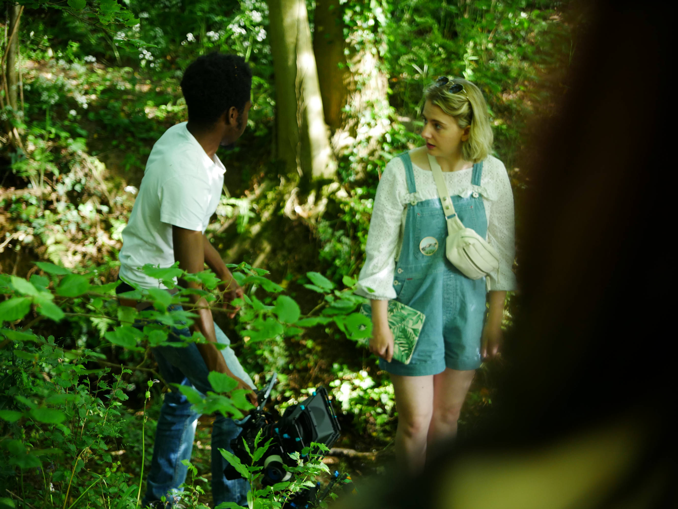 Behind the scenes photo of Director Chloe Kennedy and Director of Photography Matthias Djan deliberating on set