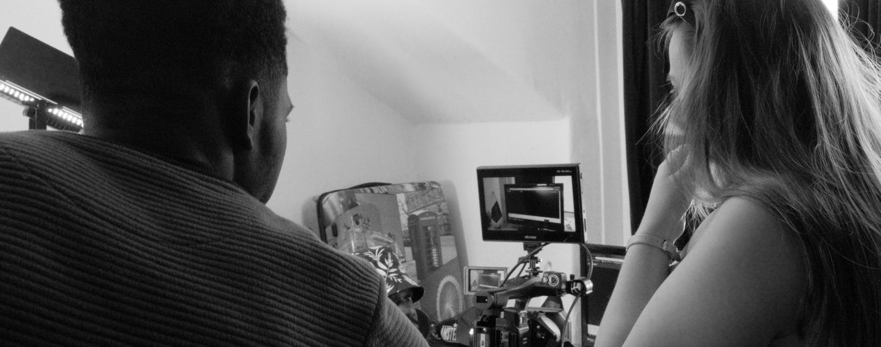 Behind the scenes photo from Movement Films narrative music video set Life Now in black and white